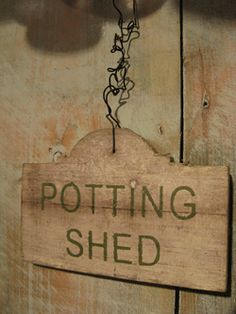 Vintage potting shed sign adds some whimsy.