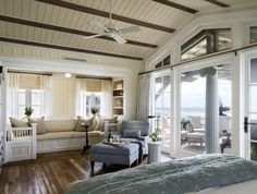 Love this master bedroom in beach house. Love the beadboard on the celing