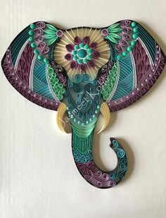 This beautiful and unique Elephant head artwork is made by glueing 1/4 inch card stock paper strips to card stock/cardboard base in a Zentangle design. The artwork is ready to be framed in 11x14 shadow box frame or a deep frame. This decorative piece uses a technique called Quilling or paper filigree. This exquisite piece is made with lots of love, hard work and patience. It will add interest and brighten up any wall or corner. Its a perfect gift for you or someone special who admir...