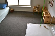 Montessori style nursery - so simple, but great use of space, lots of room to move and a mirror to see it