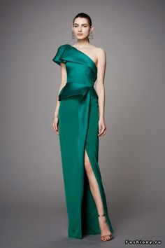 Marchesa pre-fall 2017. Beautiful emerald green one shouldered floor-length evening gown with a side slit. This would be perfect for a fancy party!