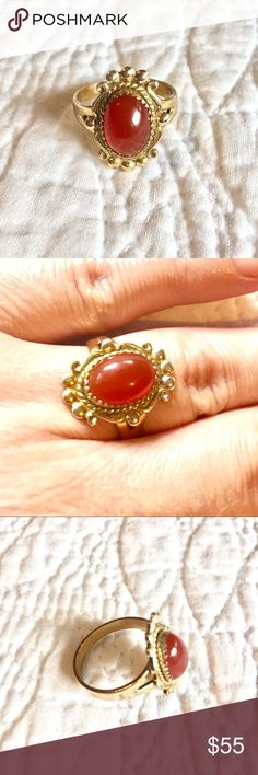 VTG Carnelian Cabochon Ring A beautiful Vintage oval shaped Carnelian Cabochon gemstone ring set in Victorian intricate 12K GF band. The ring is stamped with a Makers Mark that I can't make out and stamped 12k GF.  Size 8.  Excellent Vintage condition. Vintage Jewelry Rings