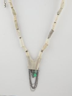 Horn Necklace by Eric Silva.  Love this, elegant and contained beading work.  Feels Ancient Modern