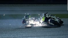 MotoGP rider Cal Crutchlow slides on the pavement Saturday, March during a qualifying session for the Grand Prix of Qatar. Despite the fall, he raced the next day and finished seventh Motorcycle Posters, Motorcycle Bike, Classic Motorcycle, Cal Crutchlow, Sports Gallery, Sports Photos, Road Racing, Sport Bikes, Custom Bikes
