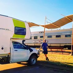 "Our Truck, ""the Nest"", and the Ghan train together in Alice Springs, NT, Australia"