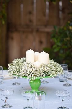 great idea! cake stand with baby's breath and candles ...but they need to be in hurricanes