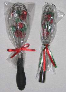 """Whisk You A Merry Christmas"" ha, how clever! The one on the right looks like pampered chef. I can help you out with one of those ;)"