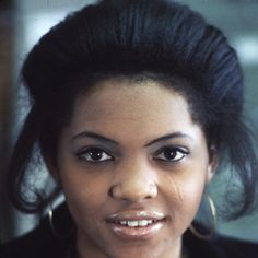 """Clarice Brown, 19, is a secretary in the United Mine Workers field Services office in Charleston, West Virginia. Her father was a miner who died of black lung disease, caused by shortage of breath as the lung sacs are filled with coal dust."""" (This photograph was taken by Jack Corn, April 1974). #historicPOC #blackhistorymonth #bhm2015 #humansofhistory African American History Month, Black History Month, Black Lungs, National Archives, Black Is Beautiful, Secretary, West Virginia, Charleston, Father"""