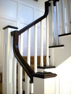 black walnut handrail, white spindles, board & batten