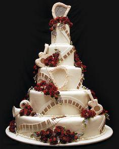 Music wedding cake. I love the piano keys running throughout the cake!