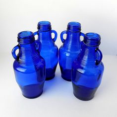 Cobalt Blue Glass Bottles with Handles (Set of - Collectible Cobalt Jug / Sure they are cute but they came with a coffee drink in them. Blue Glass Bottles, Cobalt Glass, Old Bottles, Blue Bottle, Cobalt Blue, Glass Jars, Vintage Wedding Colors, Calming Colors, Blue Walls