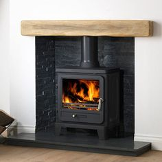 The Helios 5 Cleanburn Wood Burning and Multi Fuel Stove is an addition to the Gallery range of stoves. The Gallery Helios 5 is a wood burning stove that is Defra approved, so can be used in smoke controlled areas. Wood Burner Fireplace, Inglenook Fireplace, Fireplace Hearth, Modern Fireplace, Fireplace Design, Fireplaces, Mantle, Log Burner Living Room, Living Room With Fireplace
