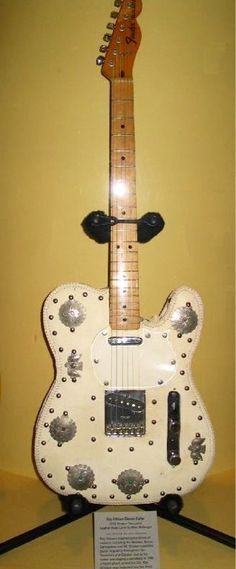 Roy Orbison's leather coated, silver embossed Fender Telecaster guitar. On display at the RRHOF annex in NYC.