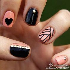 Pale pink and black: always a chic combo.  Free Nail Technician Information  http://www.nailtechsuccess.com/nail-technicians-secrets/?hop=megairmone