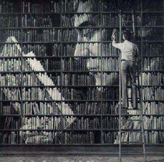 This is interesting as well as spectacular, if you think about how much time went into deciding which book to put where, as well this particular art would be extremely cost effective being that all the materials should already be there. All the parallel and horizontal lines make this image look massive.