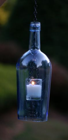 .for the garden, wine bottle candle lanterns.