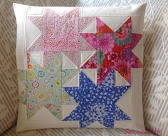 Finished and quilted Star Cluster pillow from the free BOM pattern at judymartin.com.