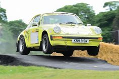 Classic Porsche Rally Car takes the jump at The Rally Show, Cornbury Park, Oxfordshire, May 14th 2011.