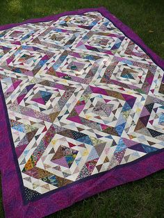 "(amazing! not ugly at all!!!  LT) This quilt started from an exchange of ""ugly fabric"" strips  (2.5 and 4.5 inches). The challenge was that we could not eliminate  any fabrics when making the quilt. We could add fabrics"