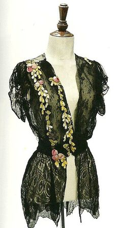 """Boue Soeurs Black Lace Tunic, 1925. Trimmed with pink silk floweres, gathered at the waist, with van dyked hem. Scanned from Christie's catalog """"Fashion Through the Ages"""", Dec 2, 2010"""