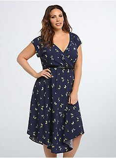 Navy blue challis keeps up a flowy appearance and a lightweight feel on this v-hem dress, while the deep V surplice neckline is structured, yet sexy. The multi-color butterfly print is vintage-inspired. #Torrid $64.50