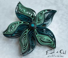 Paper quilled floral brooch