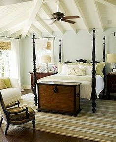 Serene farmhouse bedroom - love the beamed and planked ceiling and the antique blanket chest