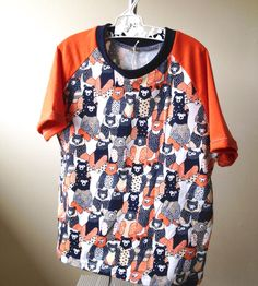 A personal favourite from my Etsy shop https://www.etsy.com/au/listing/513379251/bear-tshirt-with-orange-sleeves