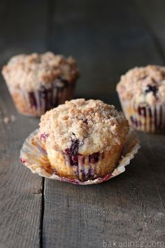 Lemon Blueberry Muffins - These muffins have so much flavor, tons of blueberries & just the right amount of lemon. bakedinaz.com #muffins