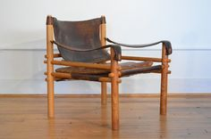 Rustic and stylish this Safari Sirocco Chair is by reputable designer Arne Norell. Made in Sweden circa 1960s of leather and solid ash wood. Note
