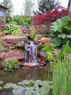 Millstone fountain stone forest santa fe photo lee for Scott and white fish pond