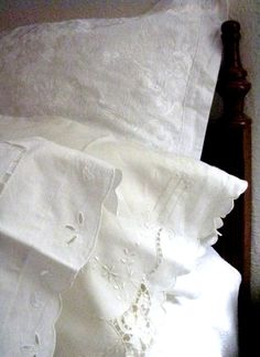dress all bedrooms in embroidered linens or damasks