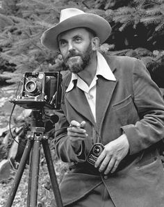 famous people with camera   photo of a bearded Ansel Adams with a camera on a tripod and a light ...