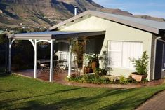 Clarens Retreat - Situated in the idyllic town of Clarens, approximately 3 ½ hours' drive from Johannesburg, Durban and Bloemfontein, Clarens Retreat offers stylish and comfortable self-catering accommodation whilst . Queen Room, Free State, New Beds, Open Plan, Entrance, National Parks, Patio, Catering, Outdoor Decor