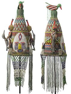 Africa | Beaded crown from the Yoruba people of Nigeria. Among the most spectacular beaded objects from Africa are the crowns of  Yoruba kings in Nigeria. Yoruba rulers wear crowns on state occasions and during public functions. Most are cone-shaped, with forms or features built up, then embellished over the entire surface with beads of vibrant colors. | © Tim Hamill