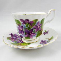 Beautiful bone china tea cup made by Royal Albert. Tea cup and saucer have purple flowers (violets) all over. Pattern is called Purple Violet, Gold trimming on cup and saucer edges. Excellent condition (see photos). The markings read: Royal Albert Bone China England Purple Violet