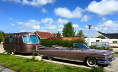 Now that's a matching set. Cadillac and camper