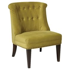 Tufted accent chair with nailhead trim and solid wood legs.  Product: Chair    Construction Material: Fabric and woo...