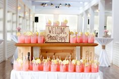 welcome drinks in mason jars! I'm a sucker for mason jars, but I love the look of this! Especially with the color of the pink lemonade to complement the coral and blue!