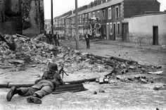 A British Army soldier on lookout in the Falls Road area of Belfast. Ref #: PA.4893379  Date: 15/08/1969
