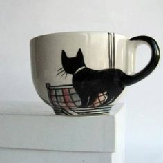 A cute cat cup idea for anybody who can draw. Well, everybody can draw. So, all set with your permanent markers?