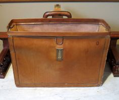 This is a rare Hartmann Natural Tan Belting Leather Lawyers Executive Gladstone Style Briefcase Attache. Hartmann literature describing this case states that it is made out of the highest quality belting leather. In its product description and directions for care of this case, Hartmann noted that this impressive belting leather acquires a lustrous patina with age. The patina of the belting leather on this used case is clear and convincing evidence that this Hartmann claim was true. This case…
