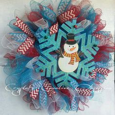 Red White & Blue Curls made from mesh are secured to a wire frame with a touch of red white and blue chevron. Adorned with an adorable little