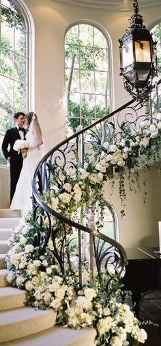Stunning floral decoration on this amazing #staircase. #weddingideas   Mode Bridal is a #luxury #bridal #boutique where #style loving #brides will find #quality and impeccable service in everything we do. www.modebridal.co.uk