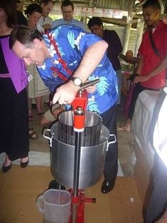 "This photo is of John Key, Prime Minister of New Zealand using the Aquarius coconut oil press while visiting Apia, Samoa in While using the press he said "" This is easier than being Prime Minister"". Making Apple Cider, John Key, Olive Press, Prime Minister, Aquarius, Coconut Oil, Grid, Merman, Aquarius Sign"