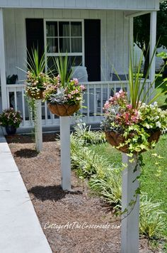 Give your front yard a distinctive look with mounted flower baskets.