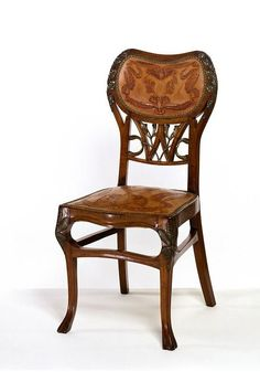 The Darras Chair, 1900. Exhibited at the International Exhibition in Paris in 1900--the exhibition which established Art Nouveau as the dominant modern style of decoration throughout Europe--this chair wowed the juries with its complicated design of undulating lines and the contrast of the formalized motifs on the leather panels depicting chestnut leaves, mistletoe and sprays of ivy. |  The Victoria & Albert Museum.