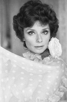 Audrey Hepburn Dotti photographed by Elisabetta Catalano at her apartment in Rome (Italy), in the Parioli area (on Via di San Valentino), in March 1976. Audrey was wearing a Valentino evening gown of yellow chiffon with white polka dots with a rose of starched satin on the neck holding a long scarf in the same tissue of the gown.