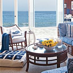 Pick up colors from the landscape and bring them into your room! Like this sea-side inspired seating area!