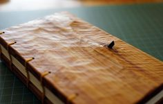 Coptic bound wooden cover with knot. http://www.lignummortuus.com/wp-content/uploads/2014/09/with-stick.jpg